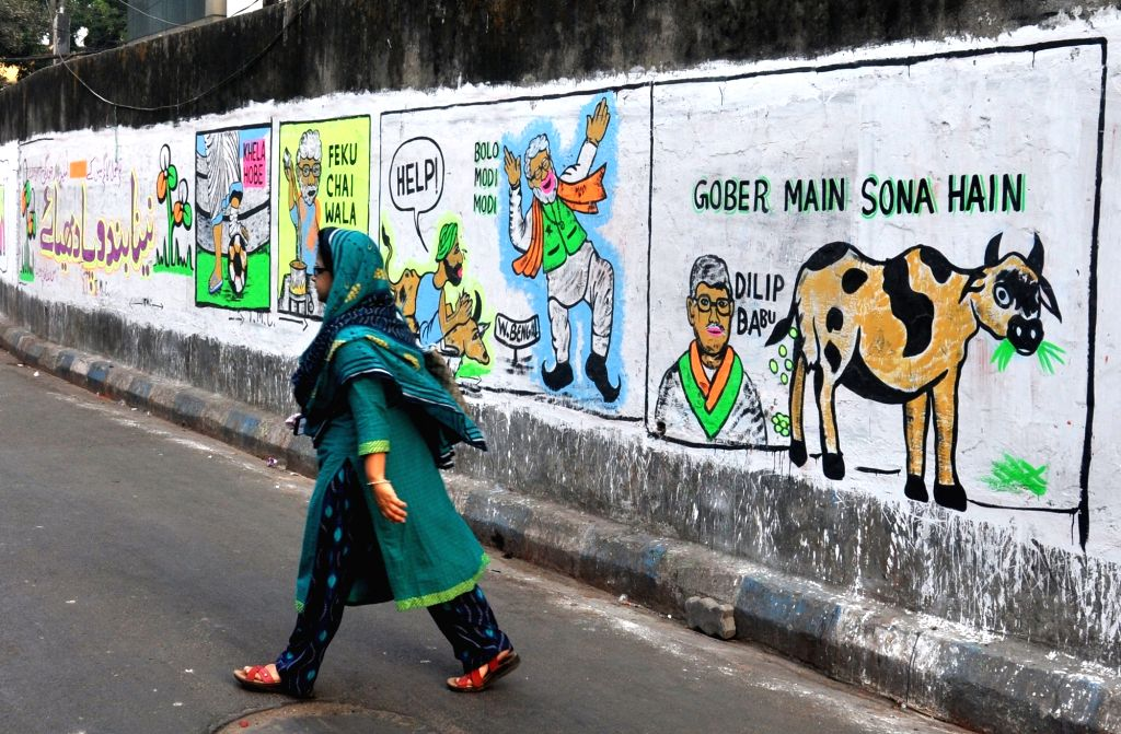 Political wall graffiti during State Assembly election in Kolkata. on April 16, 2021.