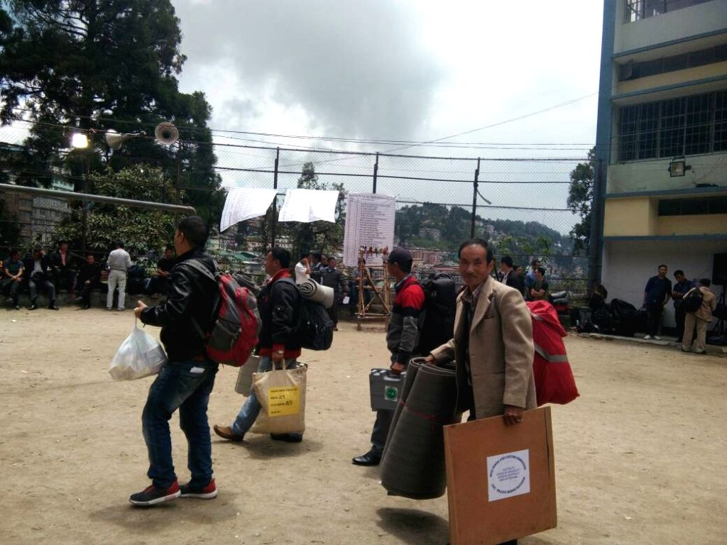 Poll personnel leave for their respective polling booths with EVMs from Darjeeling ahead of the Municipal Polls on May 13, 2017.