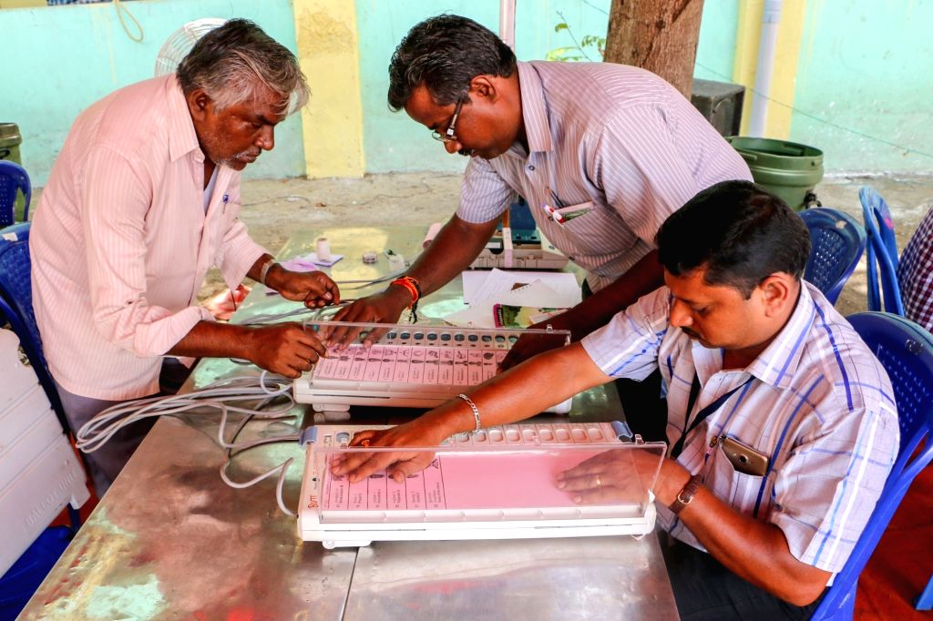 Polling officers check EVMs at a distribution centre in Chennai ahead of Tamil Nadu assembly polls on May 10, 2016.