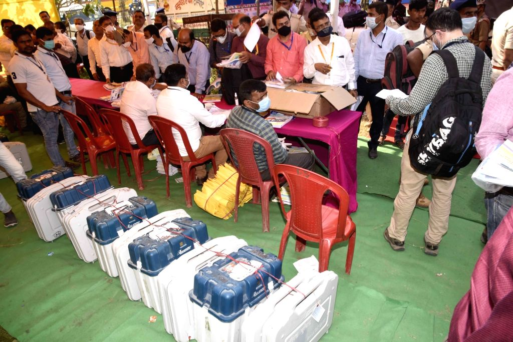 Polling officers receive EVM machines and other polling material as they leave for their respective polling stations for election duty, on the eve of the Bihar Assembly elections, at Pali in ...
