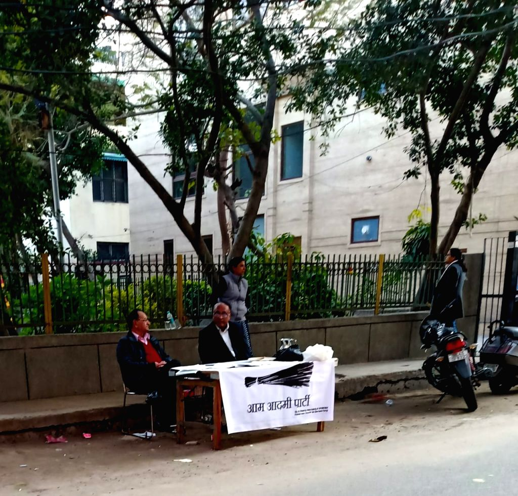 Polling officials at a deserted polling station during Delhi Assembly elections 2020, in New Delhi on Feb 8, 2020. Voter turnout in Chief Minister Arvind Kejriwal's constituency in the ... - Arvind Kejriwal