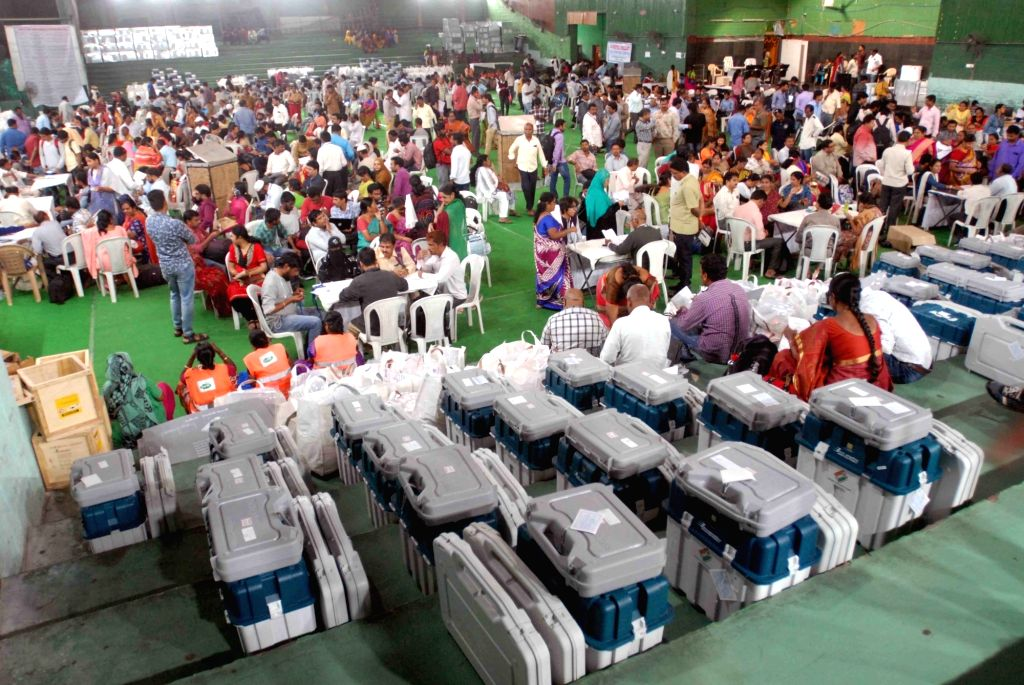 Polling officials at a distribution center on the eve of Telangana Assembly elections in Hyderabad on Dec 6, 2018.