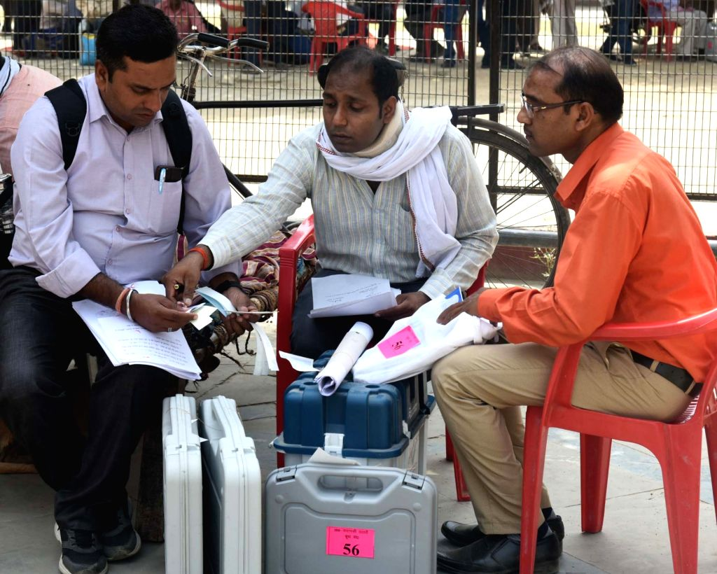 Polling officials busy checking EVMs and other necessary inputs before leaving for their respective polling stations, on the eve of the final phase of 2019 Lok Sabha elections, in Varanasi ...
