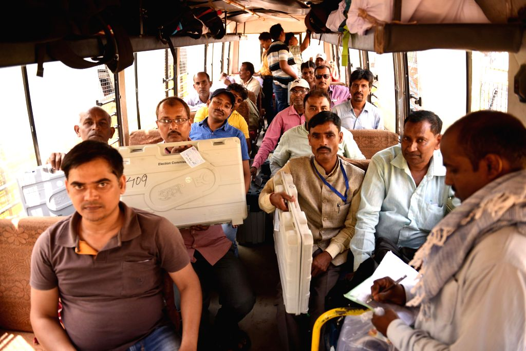 Polling officials carrying Electronic Voting Machines (EVMs) and other necessary inputs, leave for their respective?polling stations ahead of the fourth phase of 2019 Lok Sabha elections, in ...