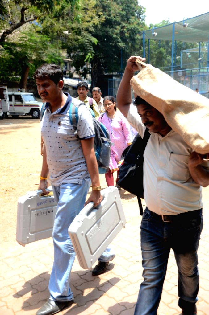Polling officials carrying Electronic Voting Machines (EVMs) and other necessary inputs, leave for their respective polling stations ahead of the fourth phase of 2019 Lok Sabha elections, in ...