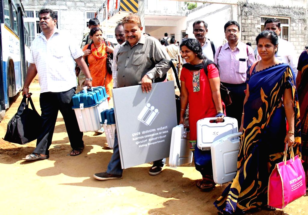 Polling officials leave for their respective booths ahead of Rajarajeshwari Nagar Assembly elections in Bengaluru, on May 27, 2018.
