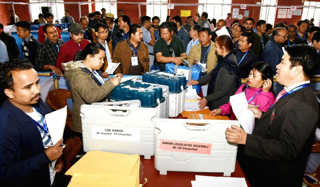 Polling officials throng the distribution centre to collect the Electronic Voting Machine (EVMs) and other necessary inputs required for the 2019 Lok Sabha polls, in Gangtok, Sikkim, on ...