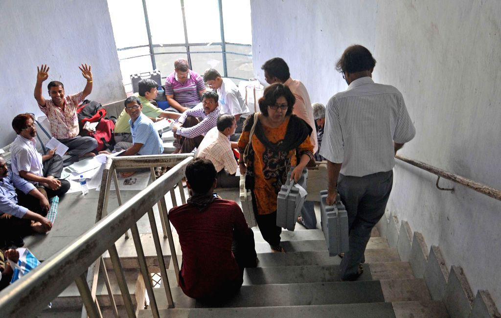 Polling personnel at an EVM and election material distribution centre ahead of 9th phase of 2014 Lok Sabha Elections in Kolkata on May 11, 2014.