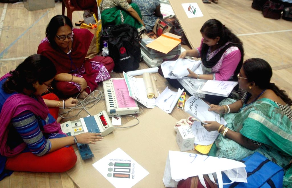 Polling personnel at an EVM and election material distribution centre ahead of West Bengal Assembly polls in Kolkata on April 20, 2016.