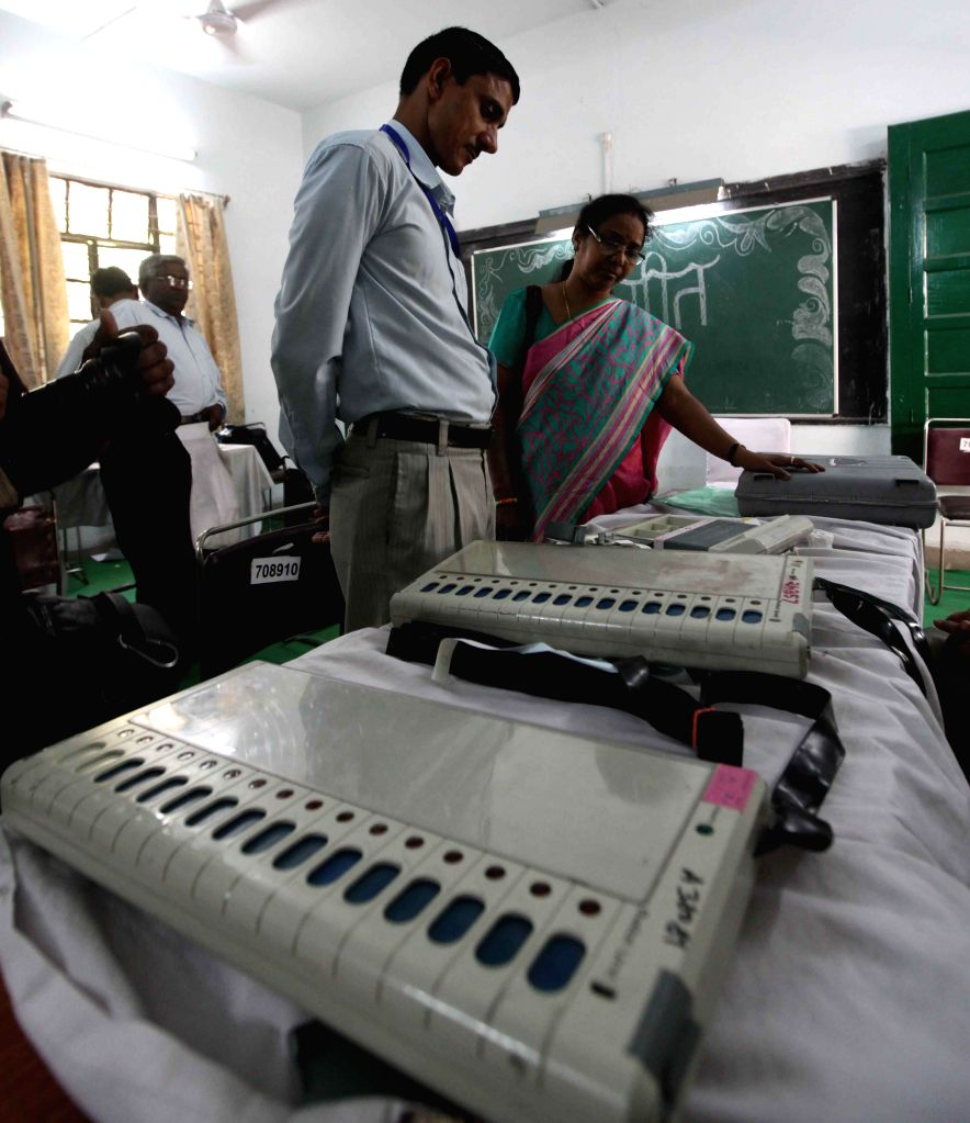 Polling personnel at an EVM (Electronic Voting Machine) distribution centre on the eve of third phase of 2014 Lok Sabha Elections in New Delhi  on April 9, 2014.