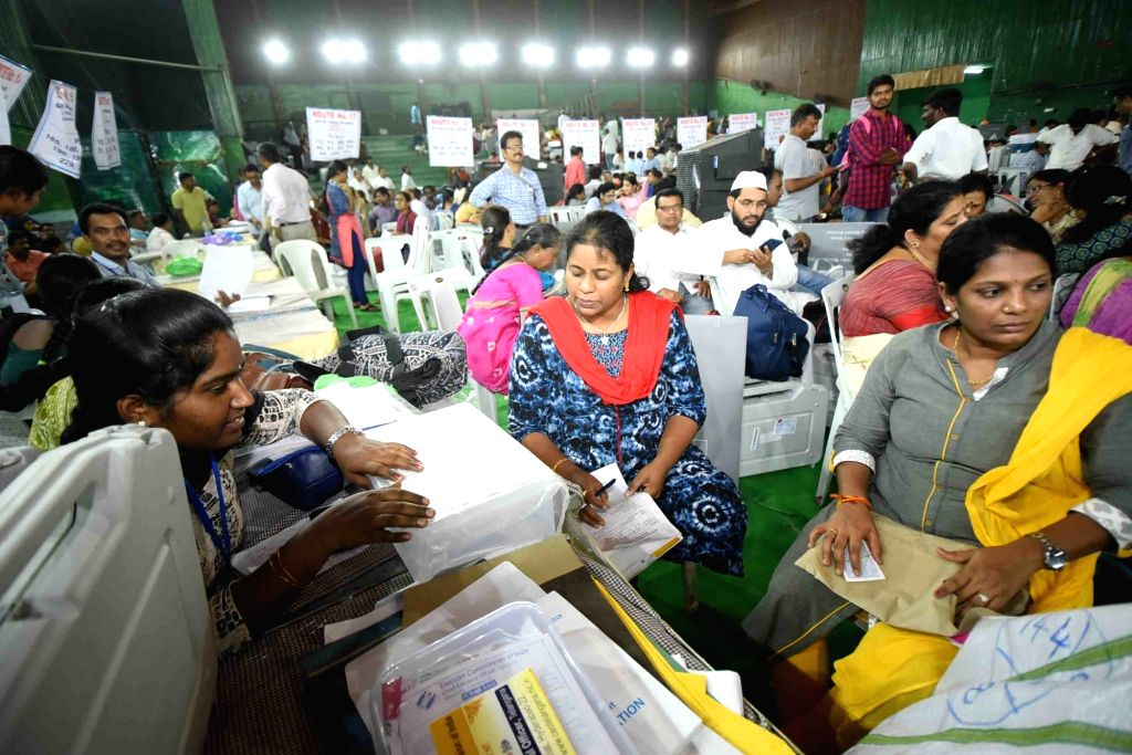 Polling personnel collect polling material from a centre in Hyderabad on April 10, 2019.