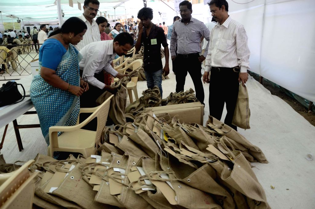 Polling personnel collect polling materials at a polling station before leaving for their respective polling booths ahead of the 6th phase of 2014 Lok Sabha Elections in Mumbai on April 23, 2014.