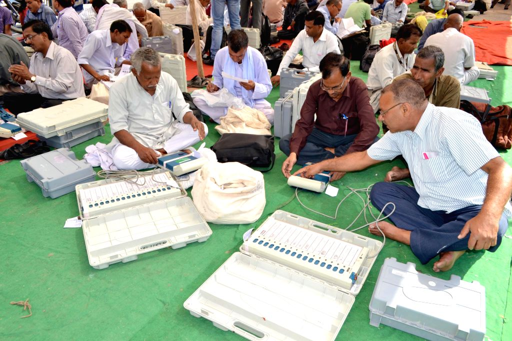 Polling personnel inspect Electronic Voting Machines (EVMs) at a polling station ahead of the 6th phase of 2014 Lok Sabha Elections in Mandi of Agra on April 23, 2014.