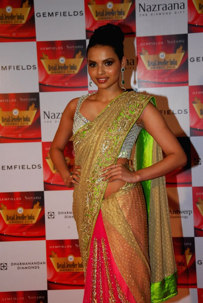 Pond's Femina Miss india Goa 2013, Gail D'Silva during the 10th Annual Gemfields and Nazraana Retail Jeweller India Awards 2014 in Mumbai on July 19, 2014. (Photo : IANS)