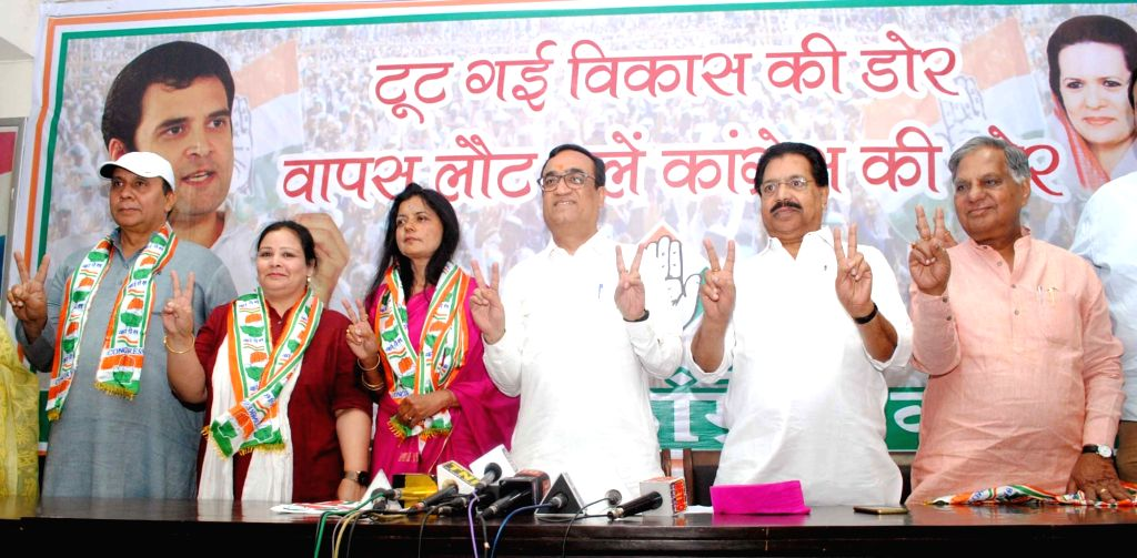 Poonam Azad, wife of BJP MP Kirti Azad joins Congress in presence of Delhi Congress chief Ajay Maken in New Delhi, on April 11, 2017.