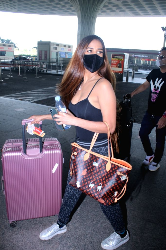 Poonam Pandey Spotted at Airport Departure on Friday 05th March, 2021. - Poonam Pandey Spotted
