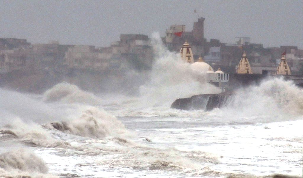 Porbandar: High waves lash the coast as Cyclone Vayu moves north-westwards skirting the Saurashtra coast in Gujarat while heavy rains have started lashing the coastal areas of the state, in Porbandar on June 13, 2019. As was feared, the 'severe cyclo