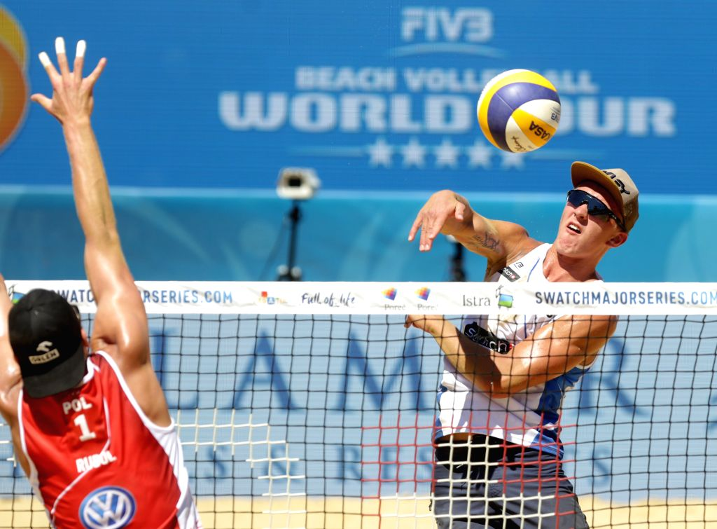 POREC, July 2, 2017 - Artem Yarzutkin (R) of Russia spikes the ball during the men's round 3 match of FIVB Swatch Beach Volleyball Major Series between Russia's Oleg Stoyanovskiy and Artem Yarzutkin ...