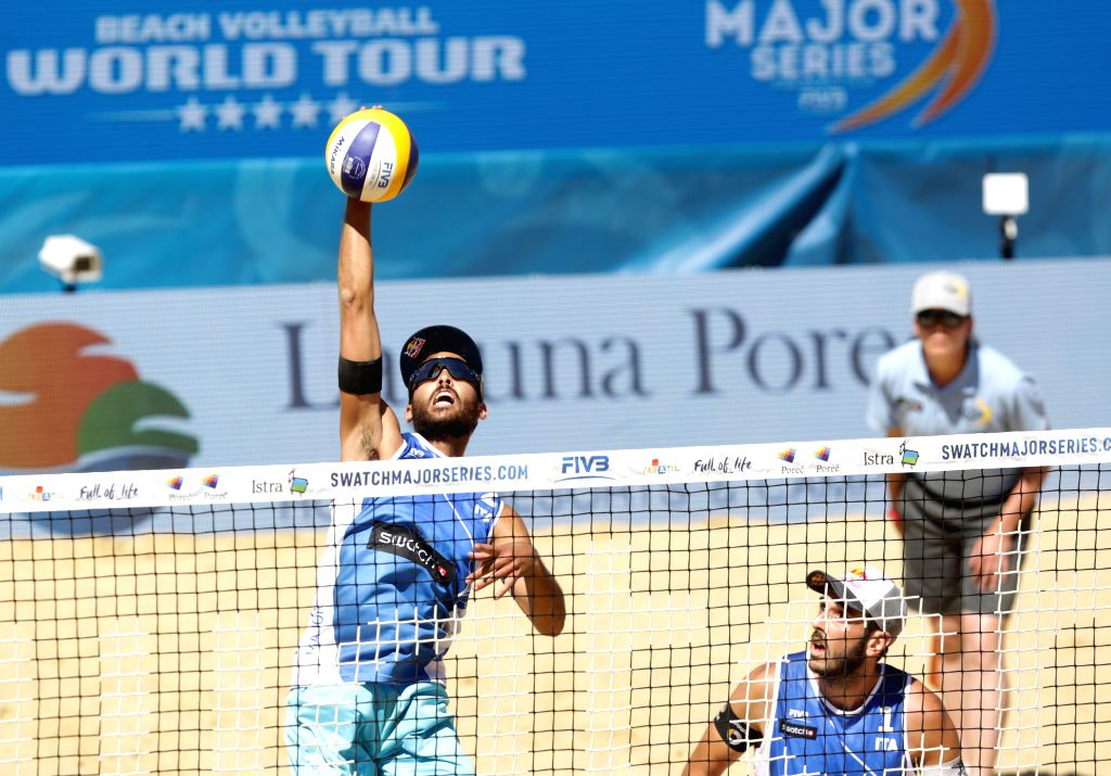 POREC, July 2, 2017 - Daniele Lupo (L) of Italy spikes the ball during the men's round 3 match of FIVB Swatch Beach Volleyball Major Series between Italy's Paolo Nicolai/Daniele Lupo and Jacob ...