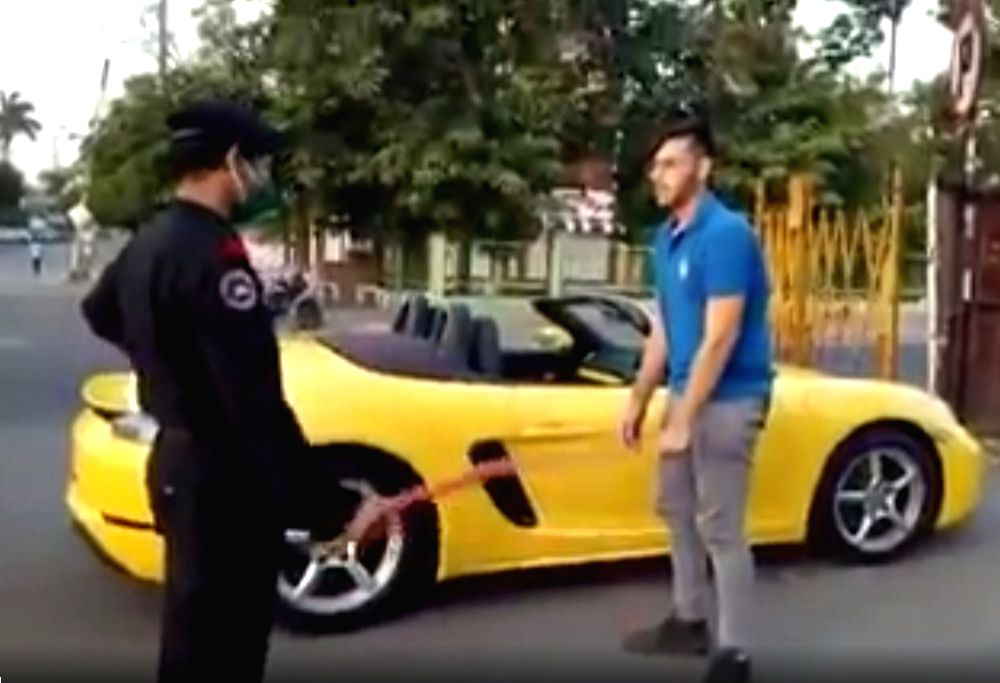 Porsche rider made to do sit-ups for not wearing mask.