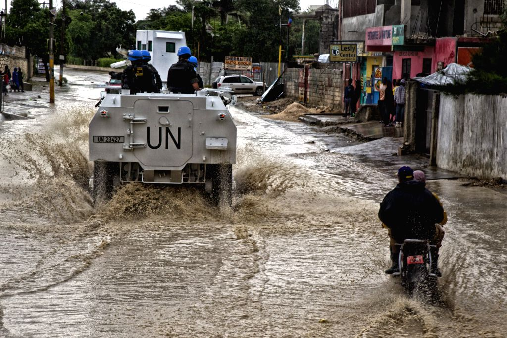 PORT-AU-Image provided by the United Nations Children's Fund (UNICEF) shows Brazilian peacemakers of the United Nations (UN) Command Force moving through a flooded ...