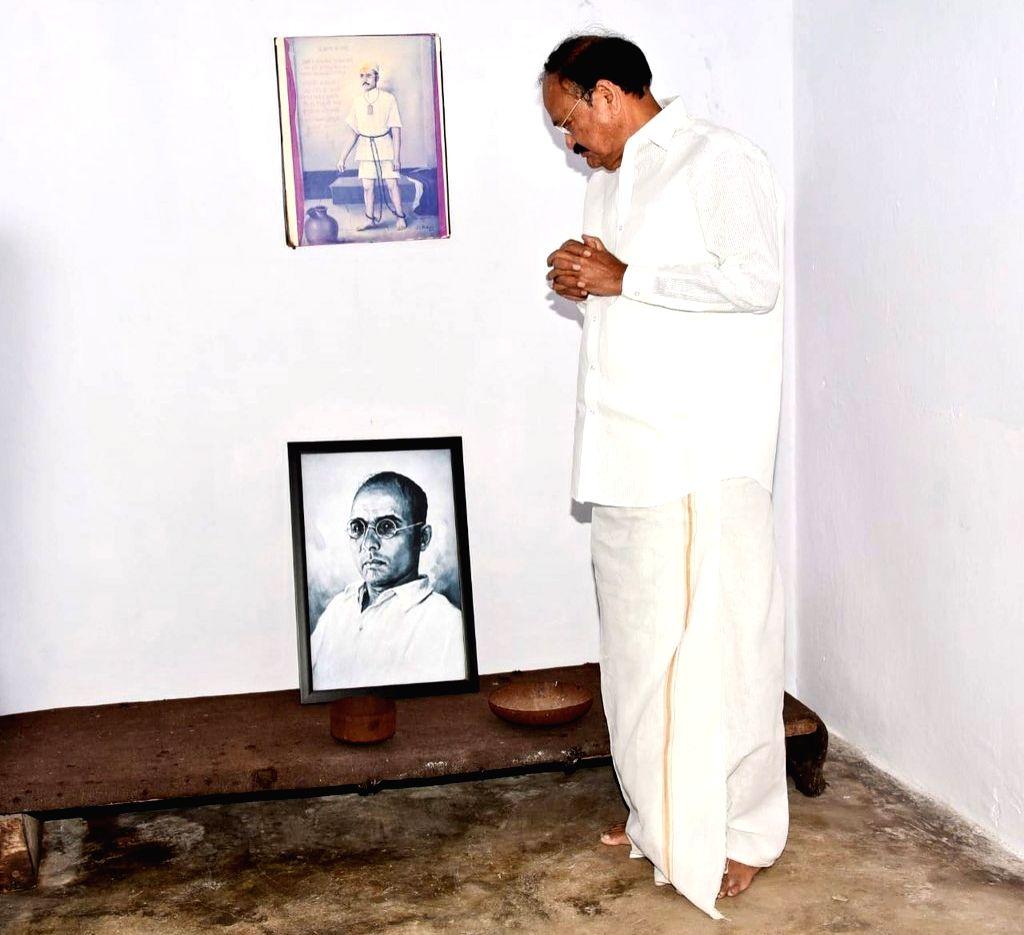 Port Blair: Vice President M. Venkaiah Naidu pays respect to Veer Savarkar during his visit to the Cellular Jail in Port Blair, Andaman and Nicobar Islands on July 5, 2018. - M. Venkaiah Naidu