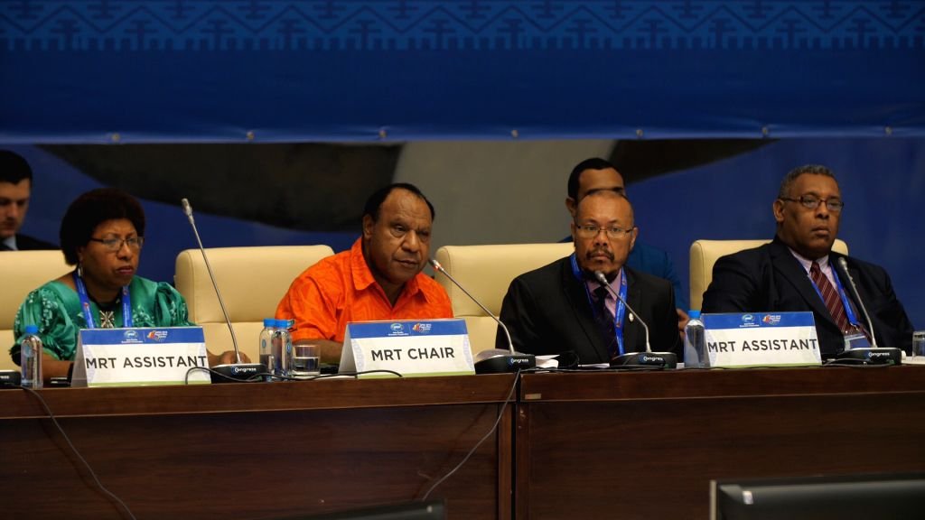 PORT MORESBY, May 25, 2018 - Rimbink Pato (2nd L), Foreign Minister of Papua New Guinea (PNG) and co-chair of the 24th APEC Ministers Responsible for Trade Meeting, delivers his opening remarks ... - Responsible