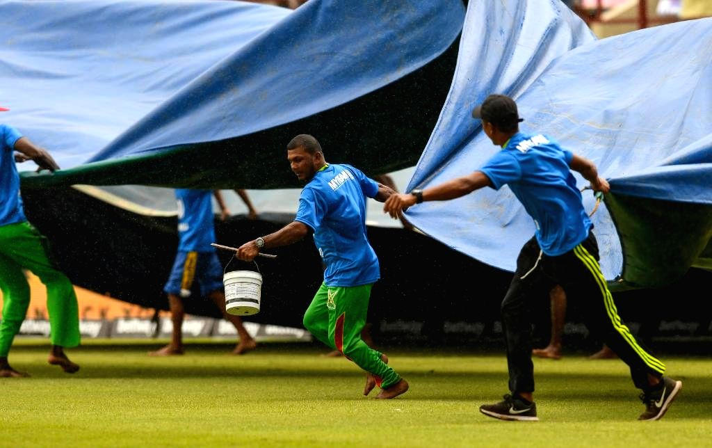 Port of Spain: Groundsmen pull on the covers as rain disrupts the 2nd ODI match between India and West Indies at Queen's Park Oval in Port of Spain, Trinidad on Aug 11, 2019.