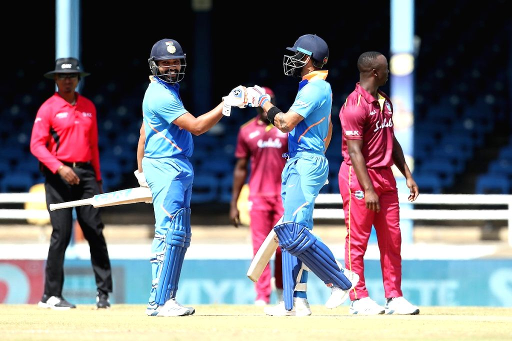 Port of Spain: Indian skipper Virat Kohli and Rohit Sharma during the 2nd ODI match between India and West Indies at Queen's Park Oval in Port of Spain, Trinidad on Aug 11, 2019. - Virat Kohli and Rohit Sharma