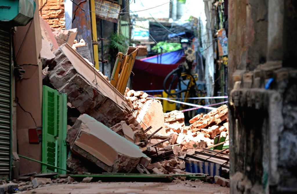 Portions of a building collapsed at Bowbazar area, where tunnel boring work for East West Metro corridor is being undertaken; in Kolkata on Sept 3, 2019.
