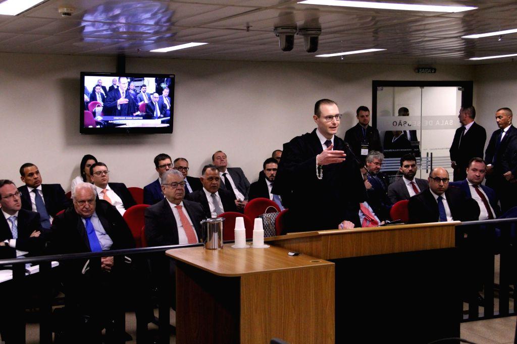 PORTO ALEGRE (BRAZIL), Jan. 24, 2018 Cristiano Zanin (front), a lawyer representing former Brazilian President Luiz Inacio Lula da Silva, speaks at an appeals court of the Federal ...