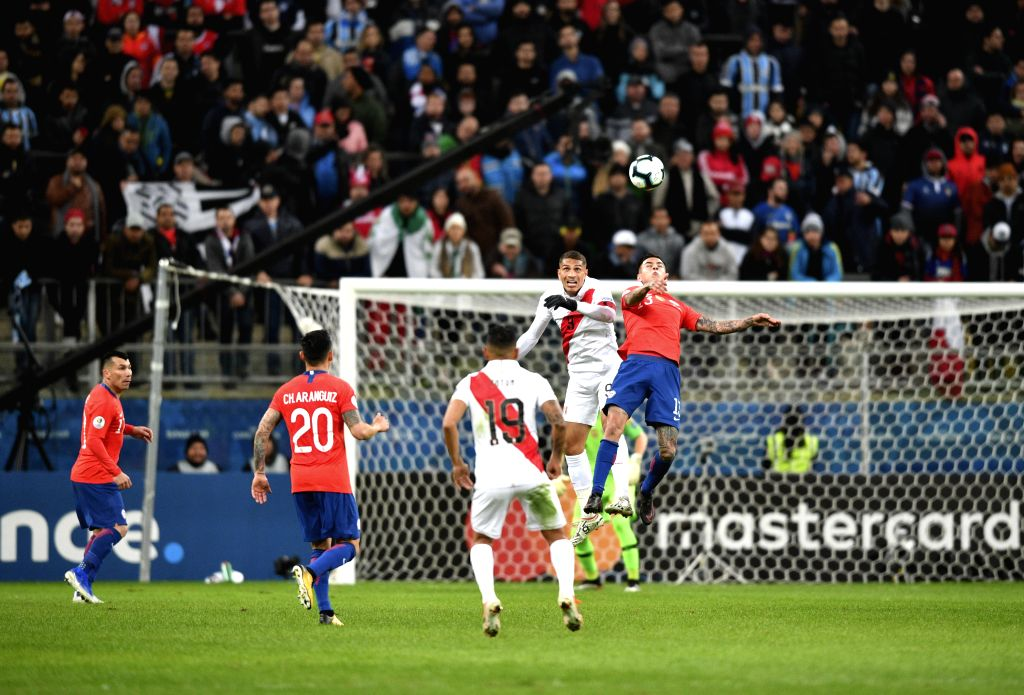 PORTO ALEGRE, July 4, 2019 (Xinhua) -- Chile's Erick Pulgar(1st R) competes with Paolo Guerrero(2nd R) of Peru during the Copa America 2019 semifinal match between Chile and Peru in Porto Alegre, Brazil, July 3, 2019. (Xinhua/Xin Yuewei/IANS)