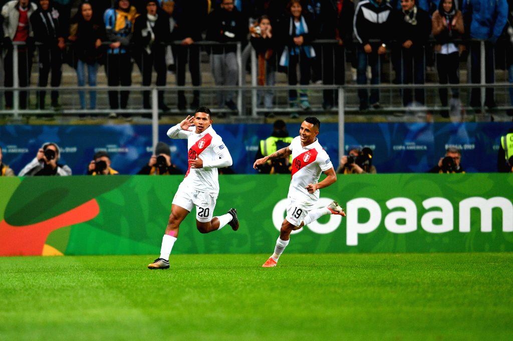 PORTO ALEGRE, July 4, 2019 (Xinhua) -- Peru's Edison Flores (L) celebrates scoring during the Copa America 2019 semifinal match between Chile and Peru in Porto Alegre, Brazil, July 3, 2019. (Xinhua/Xin Yuewei/IANS)