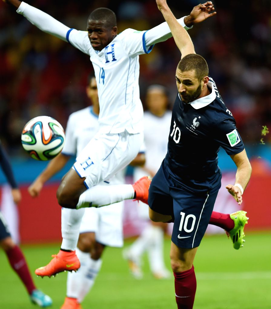 Frances's Mathieu Valbuena vies with Honduras's Oscar Garcia during a Group E match between France and Honduras of 2014 FIFA World Cup at the Estadio Beira-Rio