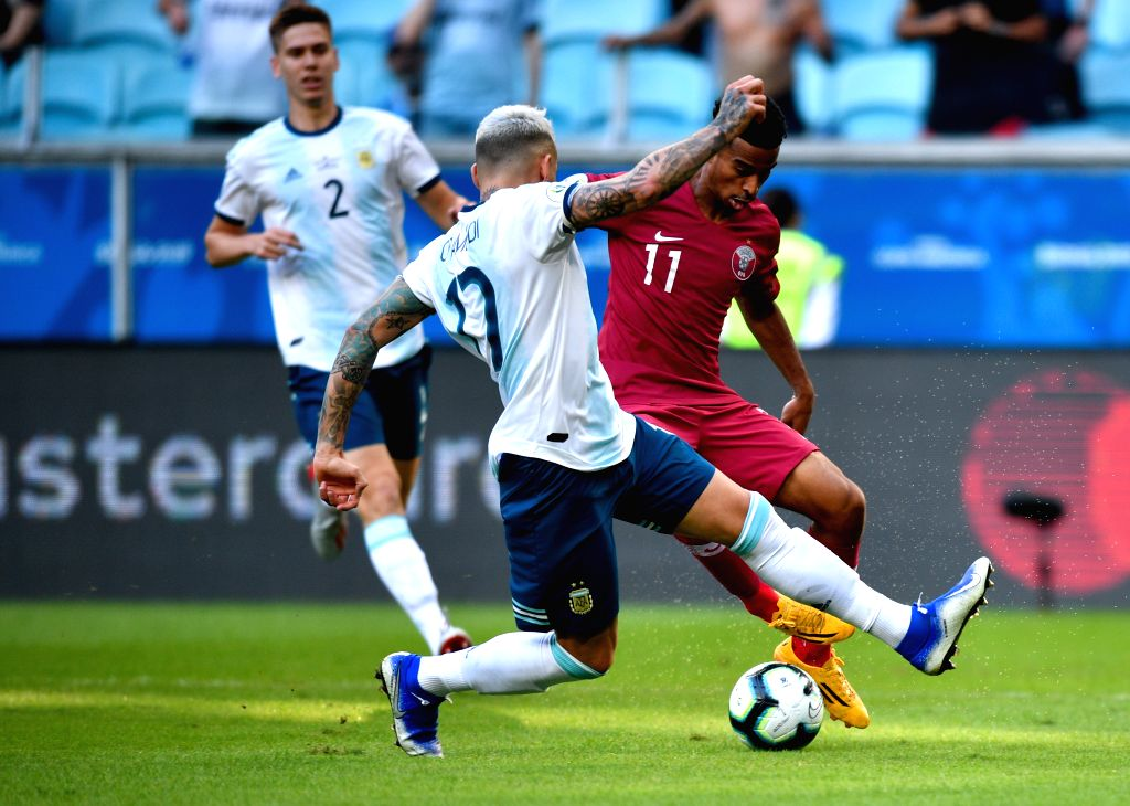PORTO ALEGRE, June 24, 2019 (Xinhua) -- Argentina's Nicolas Otamendi (L, Front) vies with Akram Afif (R) of Qatar during the Group B match between Argentina and Qatar at the Copa America 2019, in Porto Alegre, Brazil, June 23, 2019. Argentina won 2-0