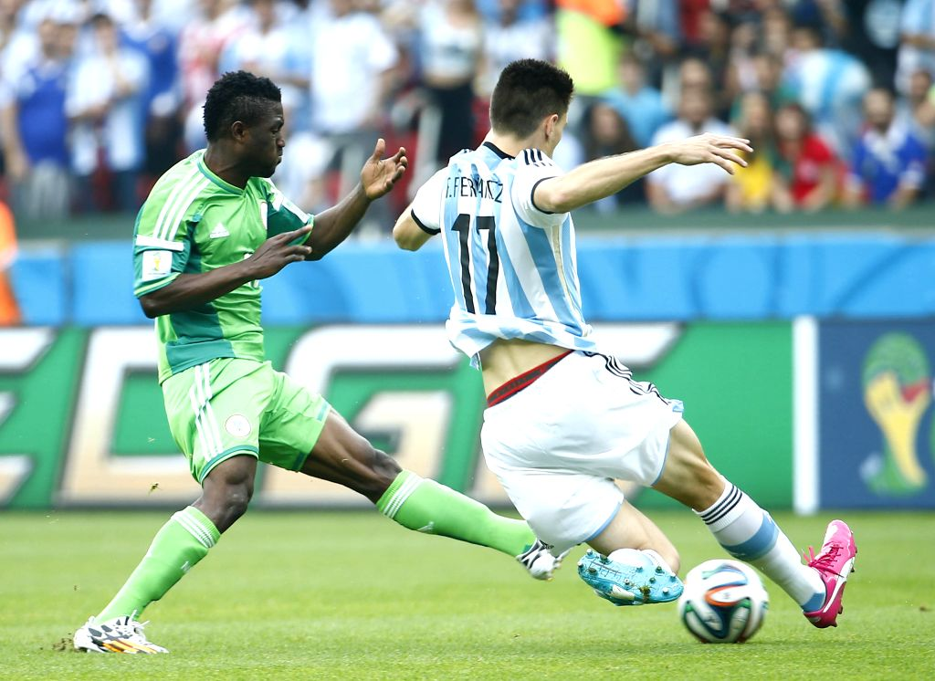 Argentina's Federico Fernandez (R) competes during a Group F match between Nigeria and Argentina of 2014 FIFA World Cup at the Estadio Beira-Rio Stadium in ...