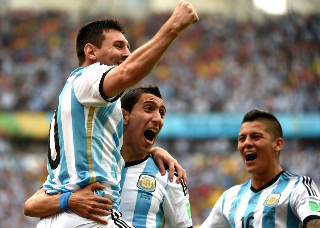 Argentina's Lionel Messi (L) celebrates for scoring a goal during a Group F match between Nigeria and Argentina of 2014 FIFA World Cup at the Estadio Beira-Rio