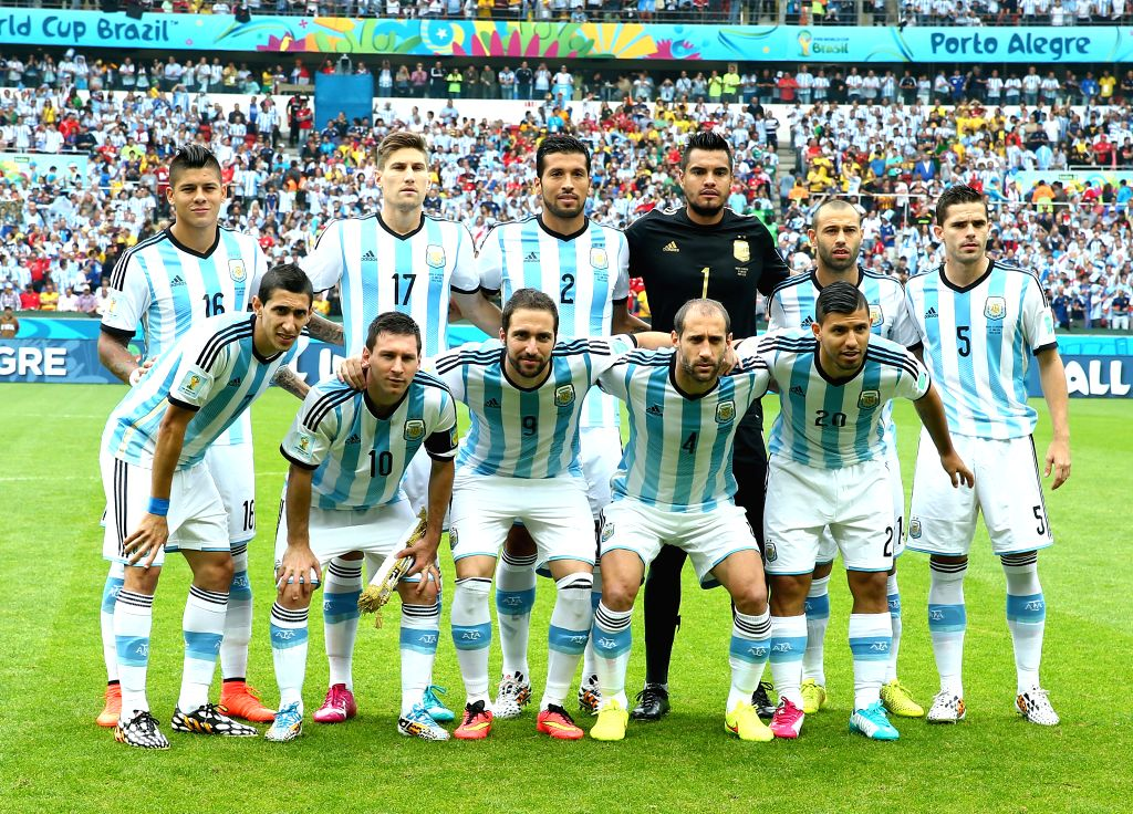 Argentina's players pose for a group photo before a Group F match between Nigeria and Argentina of 2014 FIFA World Cup at the Estadio Beira-Rio Stadium in ...