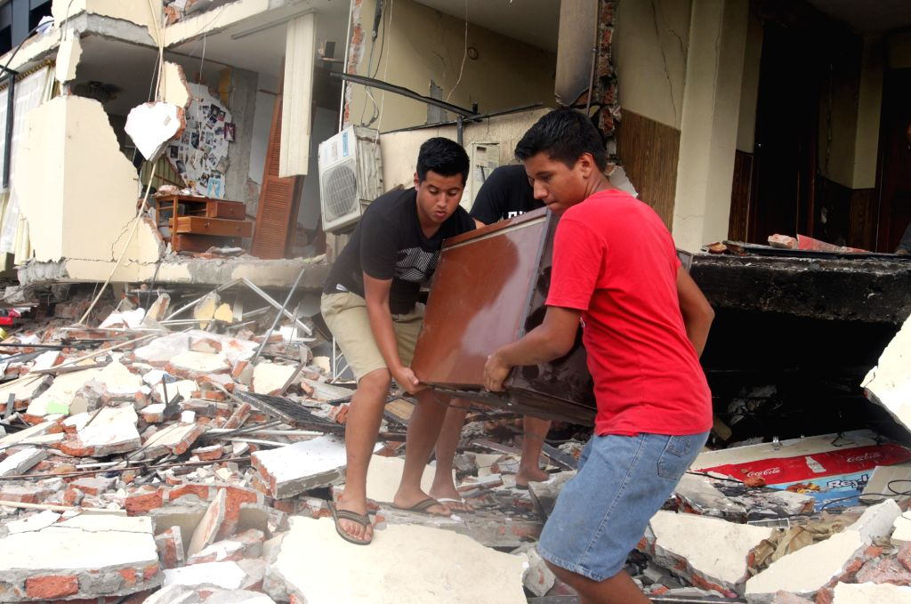 PORTOVIEJO, April 22, 2016 - Members of a family recover the belongings of their house damaged by the earthquake in Portoviejo, Ecuador, on April 21, 2016. Ecuador's Prosecutor's Office said in its ...