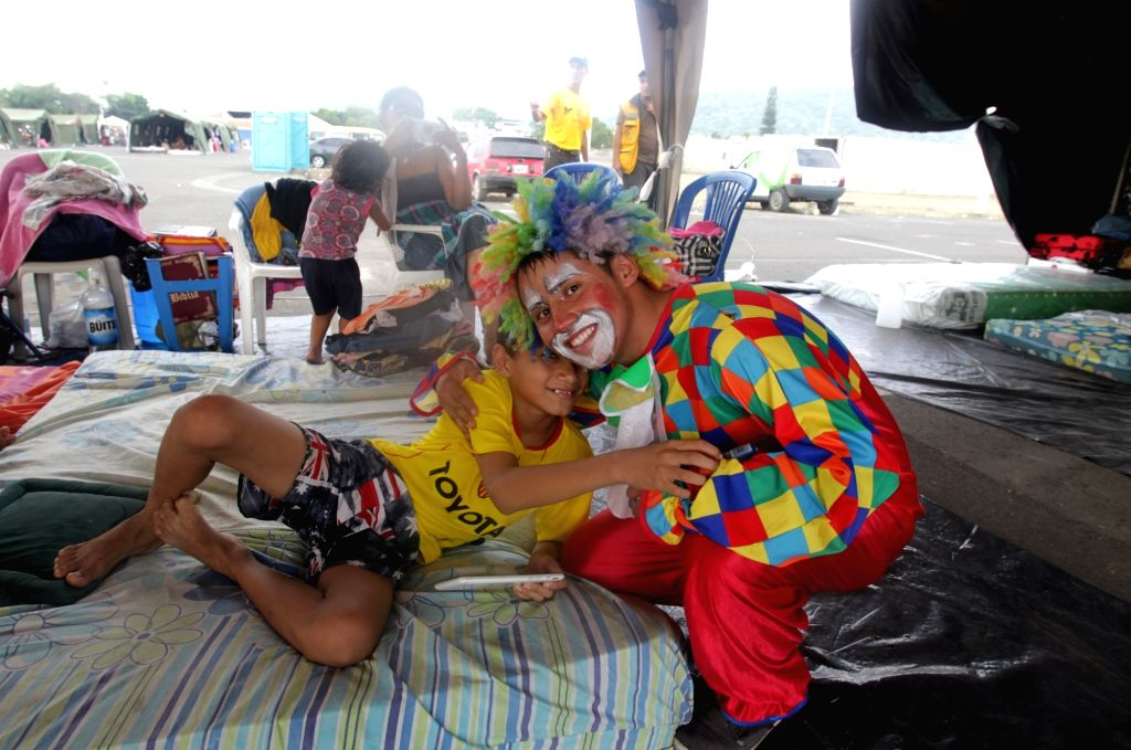 PORTOVIEJO (ECUADOR), April 22, 2016 A clown cheers up a child in a shelter installed after the earthquake at Tamarindos airport in Portoviejo, Ecuador, on April 21, 2016. Ecuador's ...
