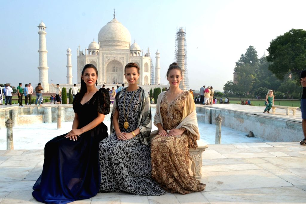 Portuguese beauty queens Sara Savery, Cristiana Viana and Venessa Souza during their visit to the Taj Mahal in Agra on Sept 18, 2016.