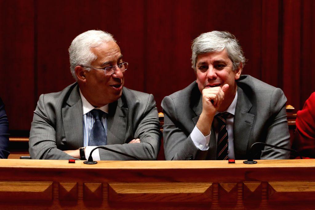 Portuguese Prime Minister Antonio Costa (L) talks with Finance Minister Mario Centeno during the State Budget 2020 final debate at the Portuguese Parliament in ... - Antonio Costa
