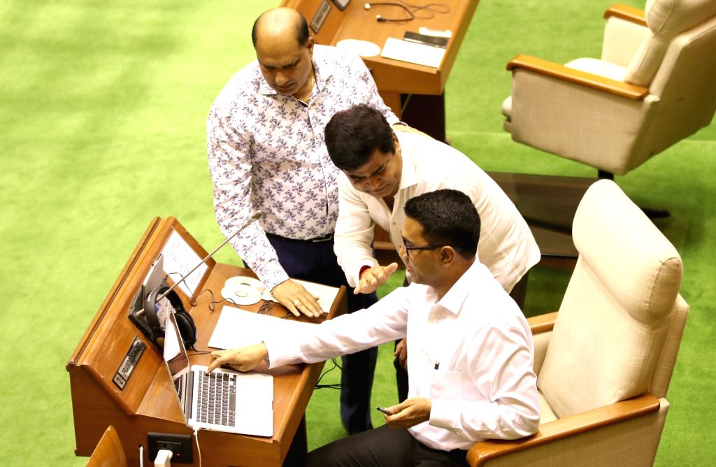 Porvorim: Goa Chief Minister Pramod Sawant in a conversation with the newly inducted Cabinet Minister Chandrakant Kavlekar on the first day of the Monsoon Session of Goa Assembly, in Porvorim on July 15, 2019. (Photo: IANS) - Pramod Sawant