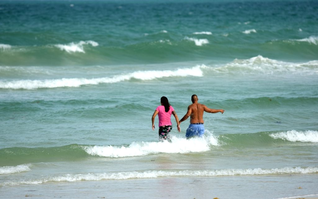 Post-lockdown tourists return to Miami Beach