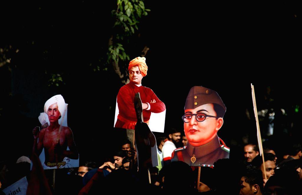 Posters of Birsa Munda, Swami Vivekananda and Chandrashekhar Azad seen during Akhil Bharatiya Vidyarthi Parishad's march supporting the Citizenship Amendment Act (CAA) 2019 and denouncing ... - Birsa Munda