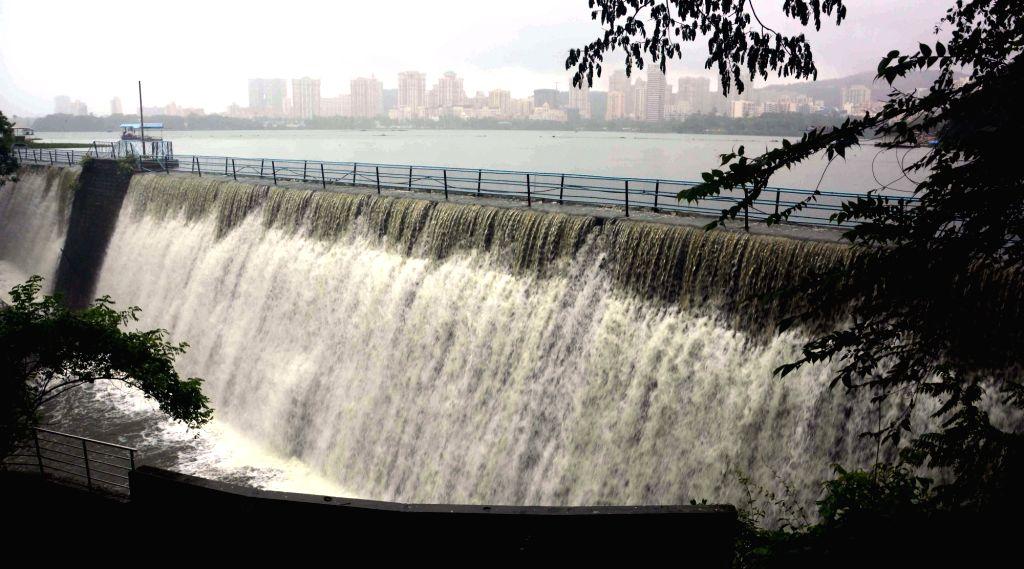 Powai Lake overflows due to heavy rainfalls in Mumbai on July 3, 2016.