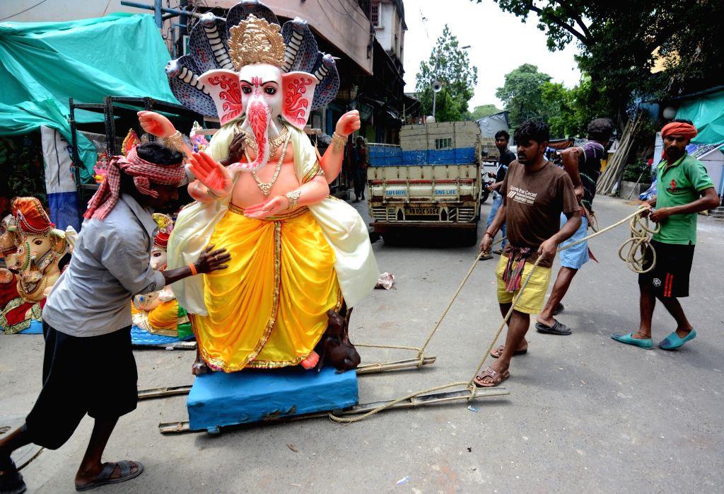 'Power cuts affecting Ganesh Chaturthi festivities in Goa'. (Photo: Kuntal Chakrabarty/IANS)