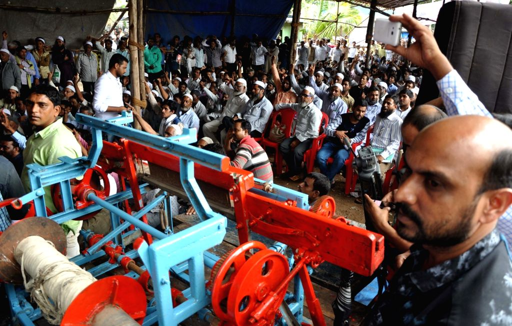 Power Loom workers stage a demonstration at Azad maiden in Mumbai on July 20, 2016.