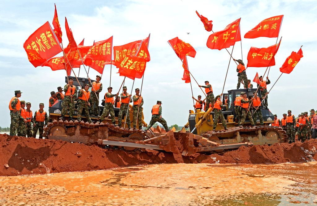 POYANG, June 24, 2016 - Soldiers celebrate closure of a breach on the Xiangyang Dyke in Guxiandu Township of Poyang County, east China's Jiangxi Province, June 24, 2016. After days of heavy rain, a ...