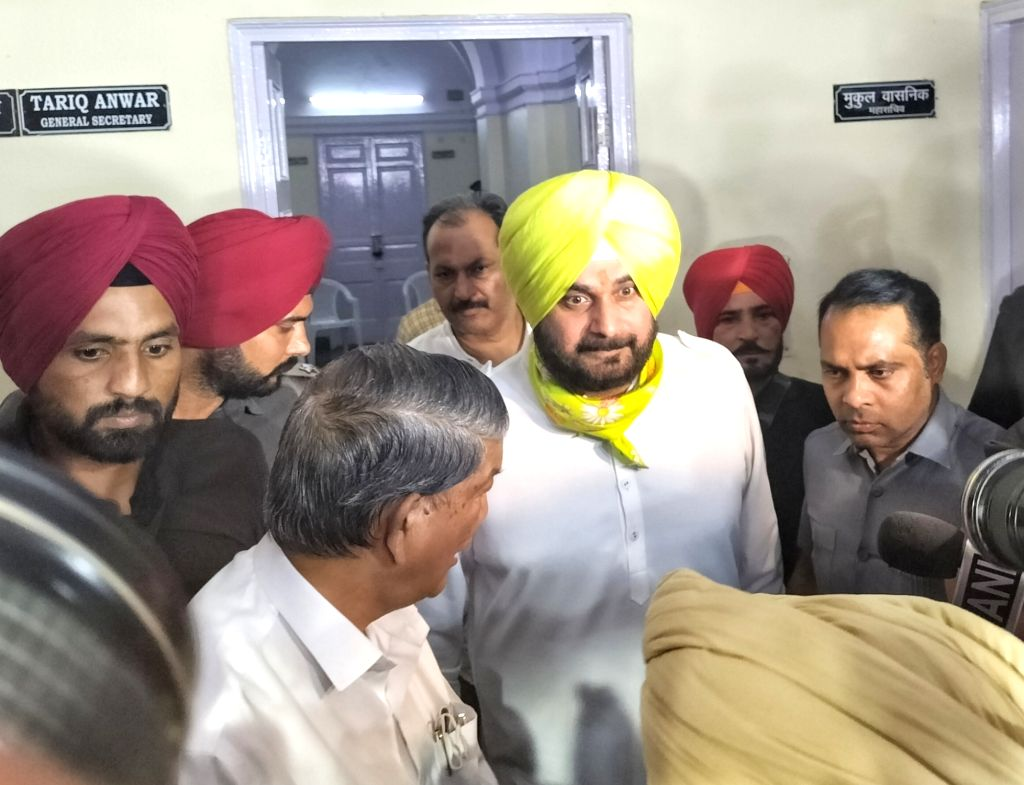 PPCC chief Navjot Singh Sidhu leaves after meeting party leaders KC Venugopal and Harish Rawat at Party Headquarter in New Delhi on Thursday October 14, 2021 - Navjot Singh Sidhu